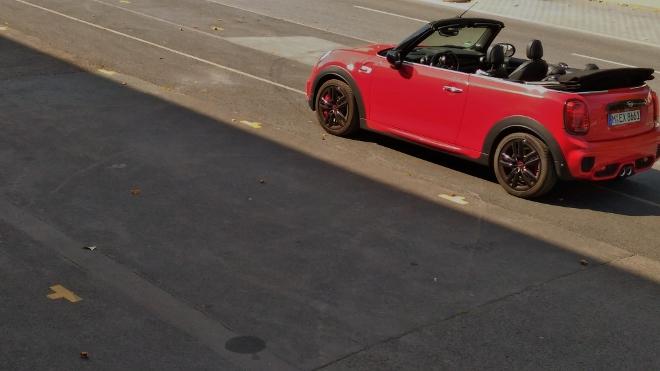 Red Mini Cabrio John Cooper Works with black rims